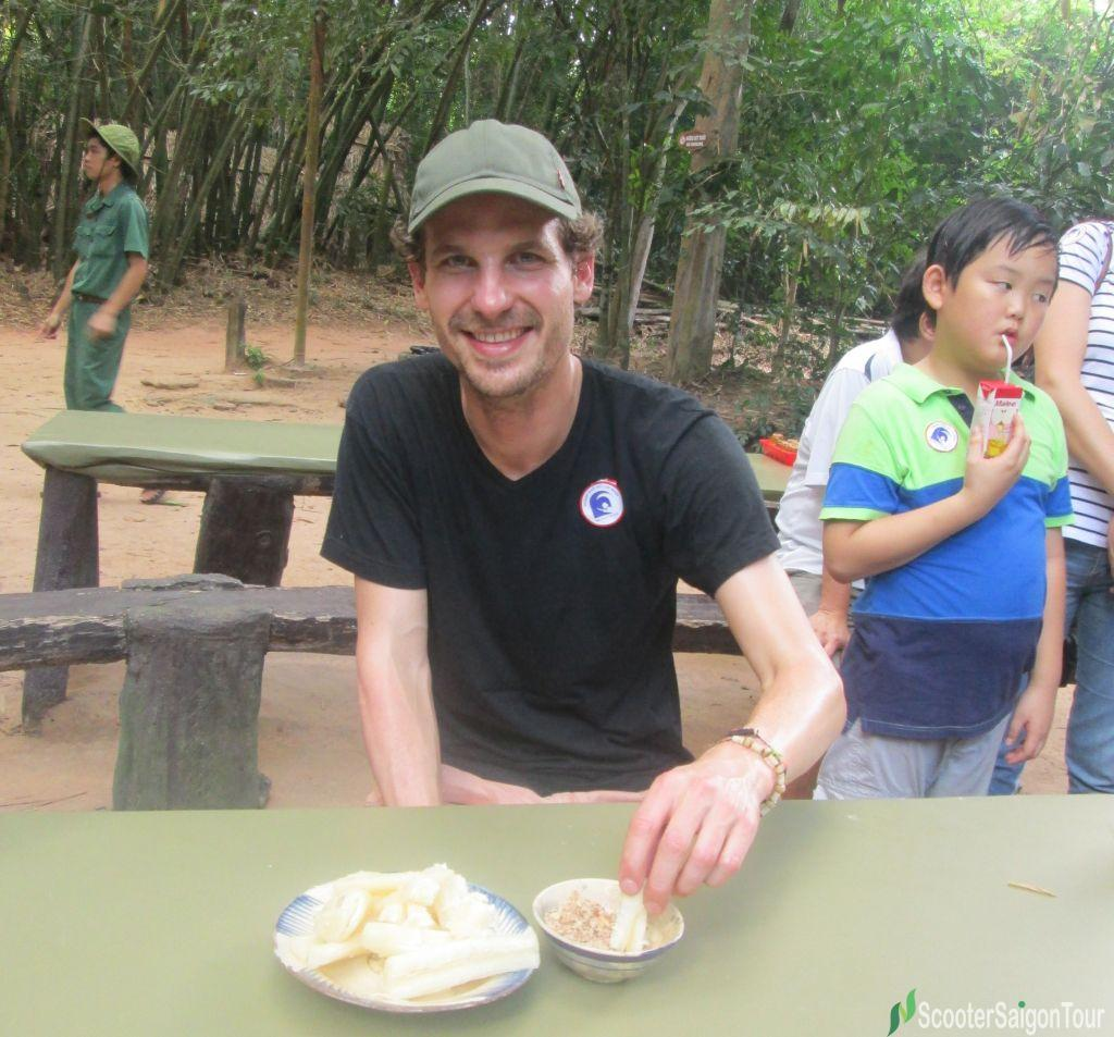 Eating Boiled Casava At Cu Chi Tunnels