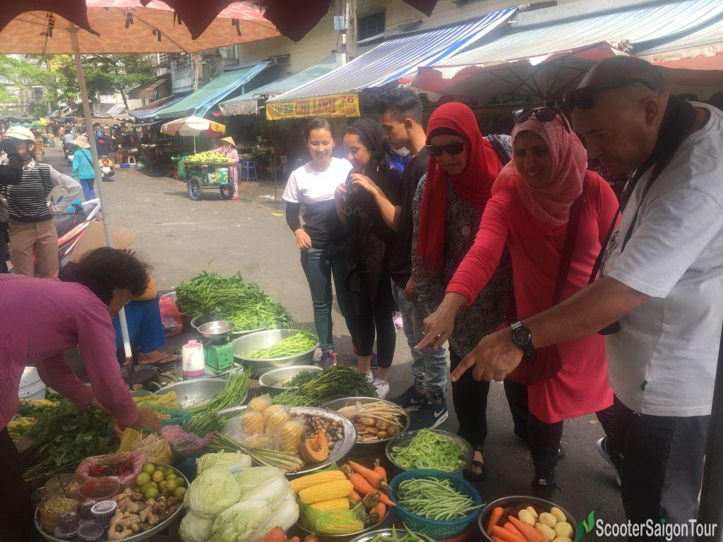 Choosing Ingredients At Local Market On Cooking Class