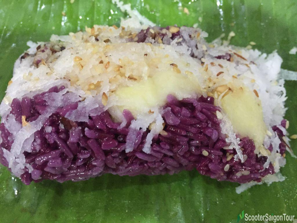 Vietnamese Steamed Sticky Rice With Magenta Juice Wrapped In Banana Leaf Or Xoi La Cam