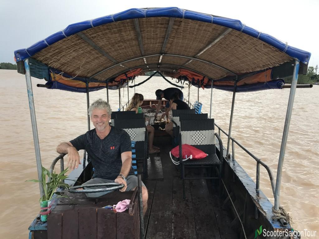 Crusing Along Rivers On Boat In Mekong Delta